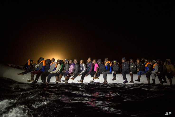 Refugees and migrants from many different African nationalities sit aboard an overcrowded rubber boat leaving Libyan territorial waters early March 5, 2017. A similar boat carrying more than 100 people sank off the coast of Libya earlier this week an...