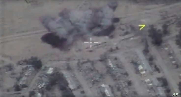 In this frame grab provided May 31, 2017 by Russian Defense Ministry press service, IS target is hit by long-range Kalibr cruise missile in the area of Palmyra, Syria.