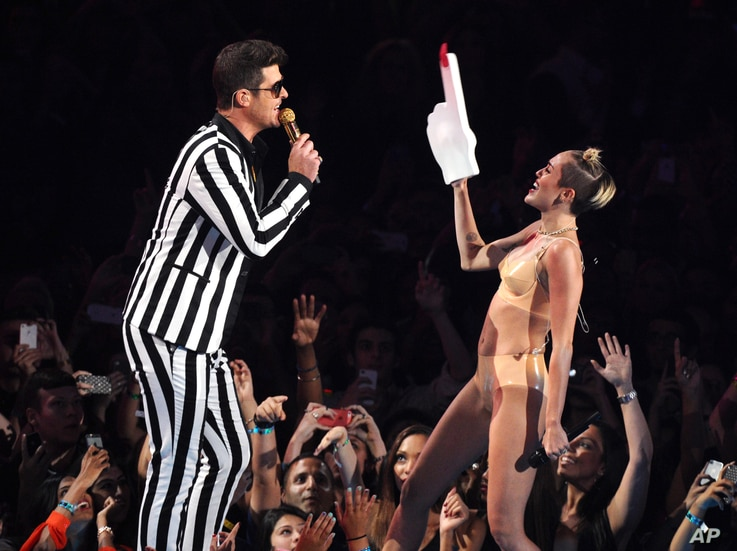 """From left, Robin Thicke and Miley Cyrus perform """"Blurred Lines"""" at the MTV Video Music Awards on Aug. 25, 2013, at the Barclays Center in the Brooklyn borough of New York."""