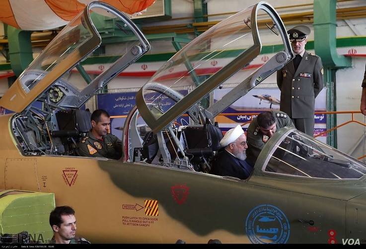 "Iranian President Hassan Rouhani inspects the cockpit of what Iran calls its new domestically designed ""Kowsar"" fighter jet, Aug. 21, 2018."