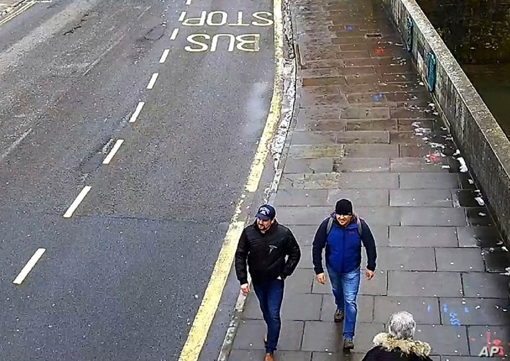 FILE - An image grab from CCTV, issued by the Metropolitan Police in London Sept. 5, 2018, shows men then identified as Ruslan Boshirov and Alexander Petrov walking on Fisherton Road, Salisbury, England, March 4, 2018. Boshirov has been unmasked as d...