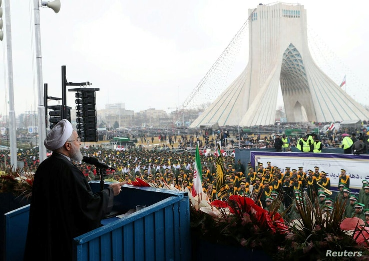 Iran's President Hassan Rouhani speaks during a ceremony to mark the 40th anniversary of the Islamic Revolution in Tehran, Iran, Feb. 11, 2019.