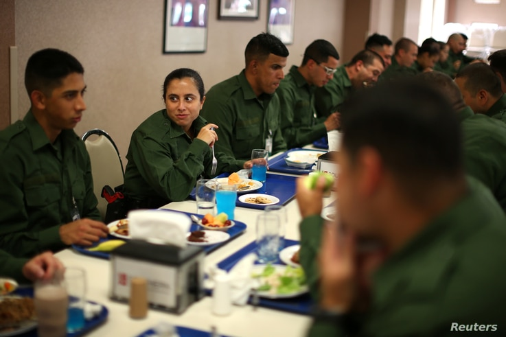 Border patrol trainee Stevany Shakare, second from left, eats lunch with other trainees at the United States Border Patrol Academy in Artesia, New Mexico, June 8, 2017.
