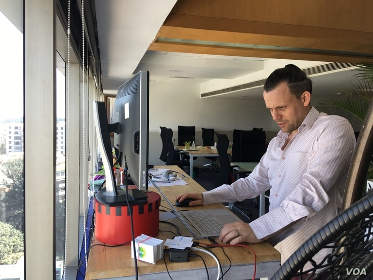 Sean Blagsvedt, an American, moved to Bangalore over 10 years ago and started his own company. (E. Sarai/VOA)