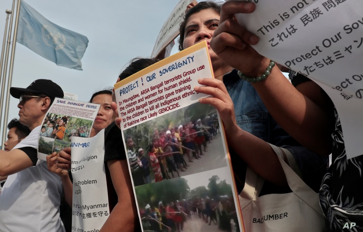 Burmese residents living in Japan, who support Myanmar's leader Aung San Suu Kyi, stage a rally against ethnic Rohingya, in front of United Nations University in Tokyo, Sept. 13, 2017.