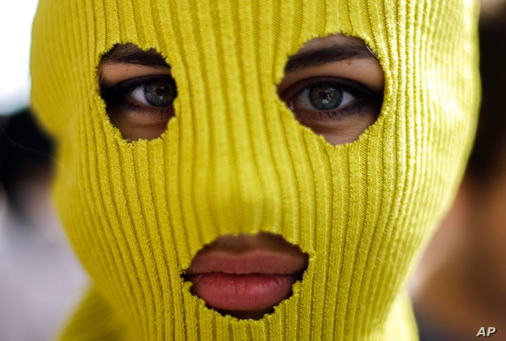 A masked demonstrator in support of the Russian punk group Pussy Riot outside Russia's embassy in Berlin.