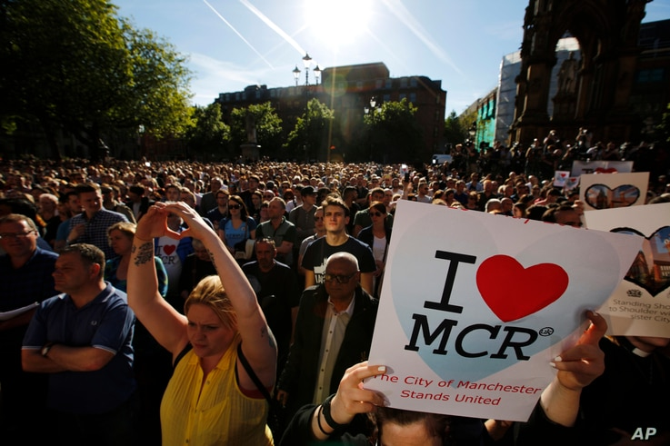 Crowds gather for a vigil in Albert Square, Manchester, England, May 23, 2017, the day after the suicide attack at an Ariana Grande concert that left 22 people dead as it ended on Monday night.