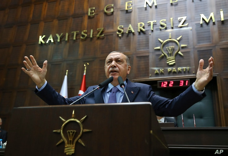Turkey's President Recep Tayyip Erdogan gestures as he deliver a speech to members of his ruling Justice and Development Party (AKP), during its weekly meeting in Ankara, Turkey, May 8, 2018.