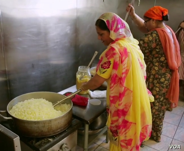 Members of the Sikh Temple in Oak Creek, Wisconsin, prepare a communal meal for the community.