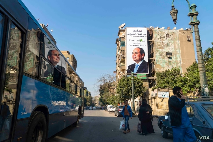 A banner as tall as a building promoting incumbent President Abdel Fattah el-Sissi's second term for president, is seen in Nasr Al-Ainy street in downtown Cairo, Egypt, March 12, 2018.