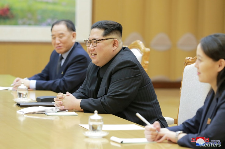 North Korean leader Kim Jong Un meets members of the special delegation of South Korea's President in this photo released by North Korea's Korean Central News Agency (KCNA) on March 6, 2018.