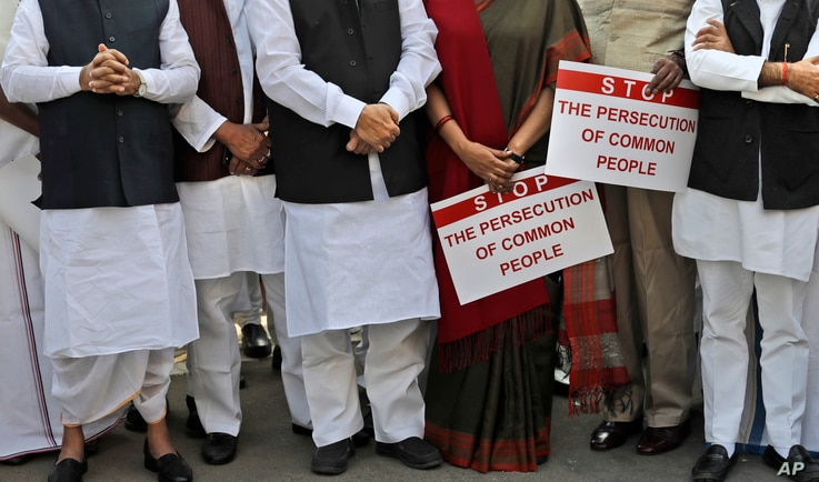 Indian lawmakers from opposition parties hold placards in the parliament premises during a protest against the government demonetizing high-value bills in New Delhi, India, Wednesday, Nov. 23, 2016.