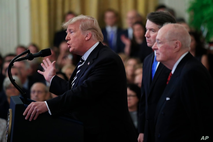 President Donald Trump, from left, with Justice Brett Kavanaugh and retired Justice Anthony Kennedy, speaks during the ceremonial swearing-in ceremony of Kavanaugh as Associate Justice of the Supreme Court of the United States in the East Room of the...