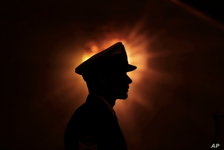FILE -A Libyan honor guard stands at attention during the arrival of U.N. Special Envoy to Libya Bernardino Leon in Tripoli, Jan. 9, 2015, in this image by photographer and video journalist Mohamed Ben Khalifa, who was killed in Libya, Jan. 19, 2019....