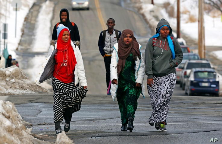 FILE - Students walk home from school in Lewiston, Maine, Jan. 26, 2016. Since February 2000, more than 5,000 Africans have come to Lewiston; now, many Somali shops, restaurants and mosques serve the city.