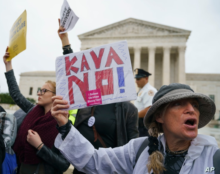 "A protester with a sign that reads ""KAVANO! I Believe Christine Blasey Ford"" calls out in front of the Supreme Court on Capitol Hill in Washington, Monday, Sept. 24, 2018."