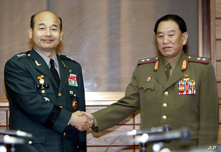 FILE - South Korean chief delegator Army Maj. Gen. Jeong Seung-jo, left, shakes hands with his North Korean counterpart Lt. Gen. Kim Yong Chol  before a military meeting at the North side of the border village of Panmunjom, North Korea.