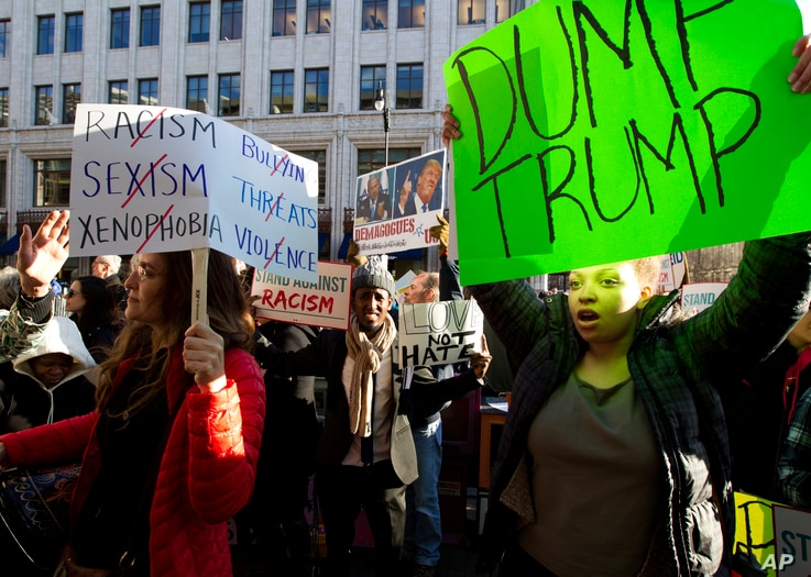FILE - Demonstrators, critical of what many see as Republican presidential candidate Donald Trump's extreme views on some issues, protest in Washington, D.C., March 21, 2016.