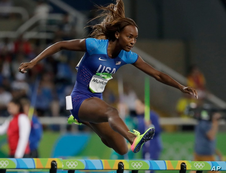 United States' Dalilah Muhammad competes in a women's 400-meter hurdles semifinal during the athletics competitions of the 2016 Summer Olympics at the Olympic stadium in Rio de Janeiro, Brazil, Aug. 16, 2016.