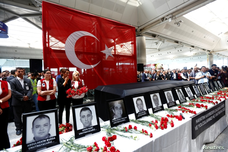 Airport employees attend a ceremony for their friends, who were killed in Tuesday's attack at the airport, at the international departure terminal of Ataturk airport in Istanbul, June 30, 2016.