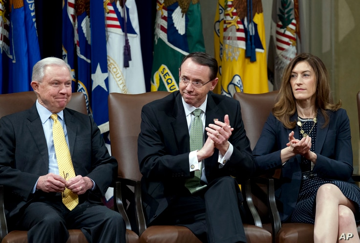 FILE - Attorney General Jeff Sessions, accompanied by Deputy Attorney General Rod Rosenstein and Associate Attorney General Rachel Brand, attend a summit at the Department of Justice in Washington, Feb. 2, 2018.