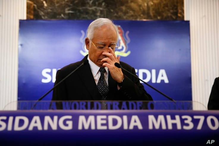 Malaysian Prime Minister Najib Razak, center, gestures before speaking at a special press conference announcing the findings for the ill fated flight MH370 in Kuala Lumpur, Malaysia, Aug. 6, 2015.
