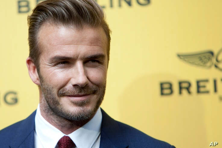 FILE - English former footballer David Beckham poses for photographers.