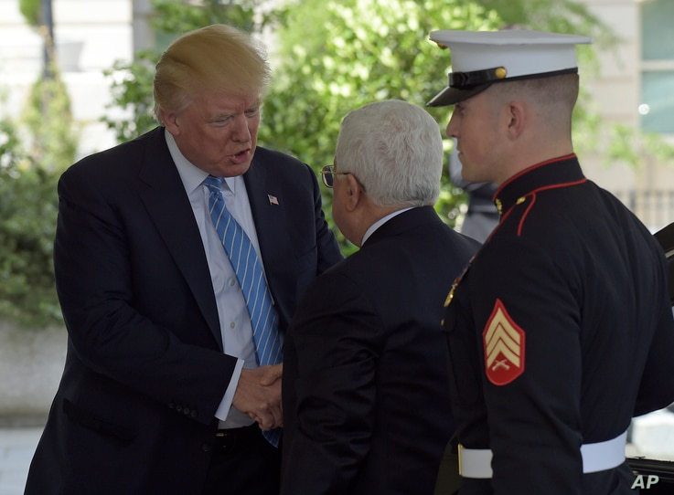 President Donald Trump, who welcomed Palestinian leader Mahmoud Abbas to the White House in Washington, May 3, 2017, will visit Abbas during upcoming Trump's first overseas trip.