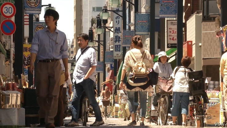 A street scene in Tokyo. Japan is averse to mass immigration – a solution other countries have used to compensate for a declining population.
