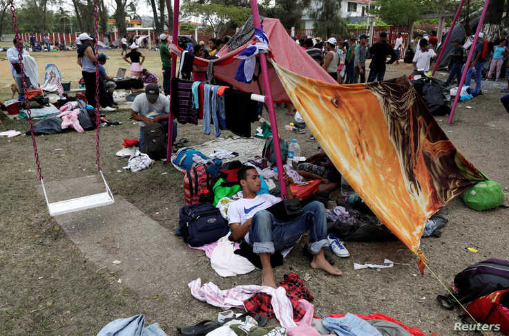 Central American migrants take a break from traveling toward the U.S., in Matias Romero, Oaxaca, Mexico, April 3, 2018.