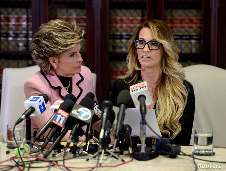 Jessica Drake speaks to reporters about allegations of sexual misconduct against Donald Trump, alongside lawyer Gloria Allred (L) during a news conference in Los Angeles, California, Oct.  22, 2016.