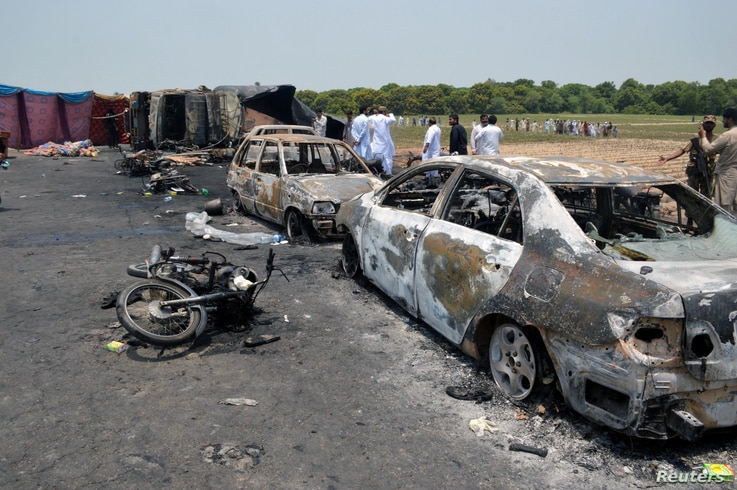 Burnt out cars and motorcycles are seen at the scene of an oil tanker explosion in Bahawalpur, Pakistan, June 25, 2017.