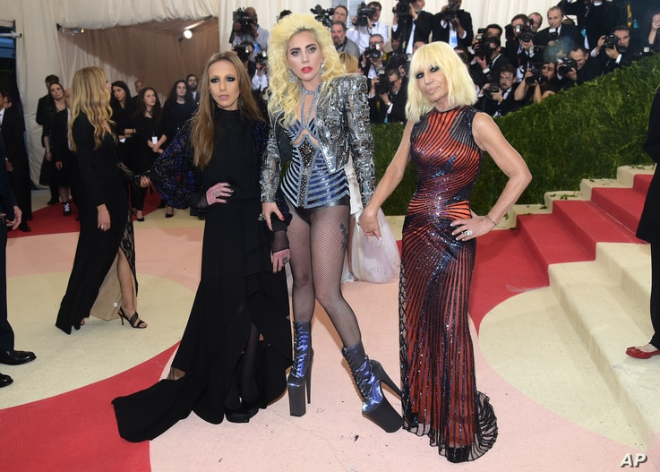 """Allegra Versace, from left, Lady Gaga and Donatella Versace arrive at The Metropolitan Museum of Art Costume Institute Benefit Gala, celebrating the opening of """"Manus x Machina: Fashion in an Age of Technology"""" on May 2, 2016, in New York."""
