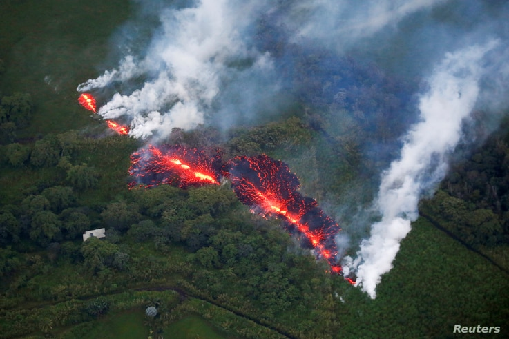 Lava erupts from a fissure east of the Leilani Estates subdivision during ongoing eruptions of the Kilauea Volcano in Hawaii, U.S., May 13, 2018.