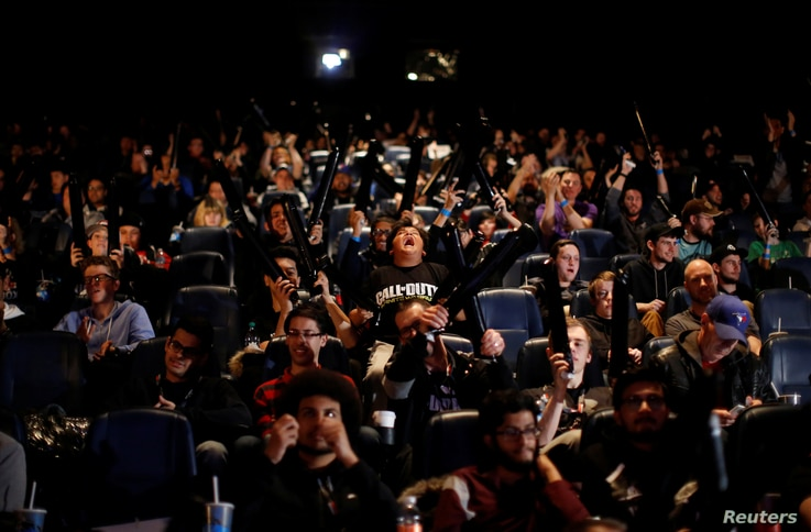 """Spectators cheer as they watch competitors play """"Call of Duty: Infinite Warfare"""" at the Cineplex WorldGaming Canadian Championship Series in Toronto, Ontario, March 26, 2017."""