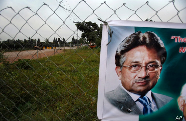 FILE - A poster of former Pakistani President Pervez Musharraf is seen hung up near a checkpoint outside his house, where he has been held under house arrest in Islamabad, Pakistan, Wednesday, Nov. 6, 2013.