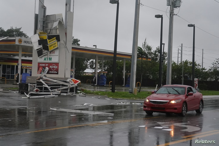 A gas station sign lays destroyed after Hurricane Irma blew though Fort Lauderdale, Florida, Sept.10, 2017.