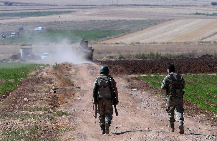 Turkish soldiers patrol near the border with Syria, ouside the village of Elbeyli, east of the town of Kilis, southeastern Turkey, July 24, 2015.
