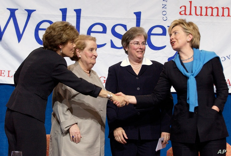 FILE - From left, Wellesley College President Diana Chapman Walsh, former Secretary of State Madeline Albright, U.S. Court of Appeals Judge Susan P. Graber and then-Sen. Hillary Clinton gather onstage following a panel discussion before alumnae at We...