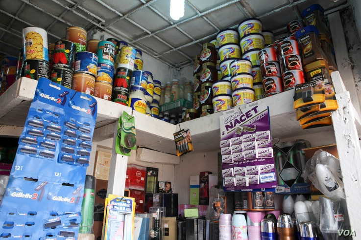 Provisions are displayed at a store in Obalende market in Lagos, Nigeria, March 3, 2016. (C. Stein/VOA)