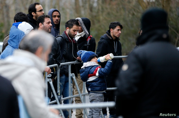 Migrants wait for their registration in front of the Federal Office for Migration and Refugees at Berlin's Spandau district, Germany, Jan. 29, 2016.