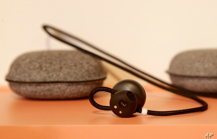 FILE - Google Pixel Buds on display at a Google event in San Francisco, Oct. 4, 2017.