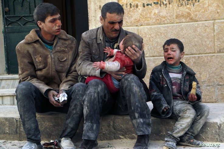 A man holds a baby saved from under rubble, who survived what activists say was an airstrike by forces loyal to Syrian President Bashar al-Assad in Masaken Hanano in Aleppo February 14, 2014. REUTERS/Hosam Katan (SYRIA - Tags: POLITICS CIVIL UNREST C...