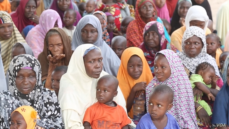 Women wait for free baby food donations from the U.N.'s World Food Program in Maiduguri, Nigeria,  October 2016. (C. Oduah/VOA)