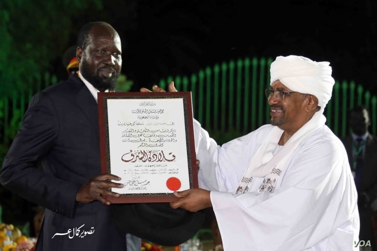Sudanese President Omar al-Bashir, right, organized a peace award ceremony in Khartoum over the weekend of Sept. 21, 2018 to reward South Sudan Salva Kiir, left, and Rebel leader Riek Machar for signing the revitalized peace deal.