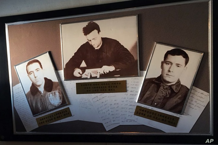 Grainy, black-and-white photos of the captain and captured crew hang in the USS Pueblo in Pyongyang, North Korea, Jan. 24, 2018. The spy ship, on display in Pyongyang, is the only commissioned US Navy ship held by a foreign government.
