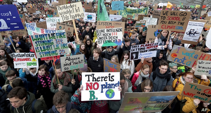 """Students attend a protest ralley of the """"Friday For Future Movement"""" in Berlin, Germany, March 15, 2019."""