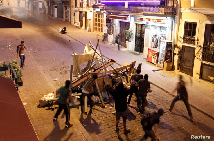 Anti-government protesters clash with riot police at Taksim in central Istanbul July 20, 2013. Turkish police fired water cannon on Saturday to disperse hundreds of protesters who gathered to march to Gezi Park in central Istanbul, which has been at ...