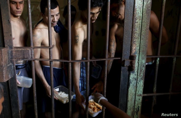 Inmates line up for food provided by the prison in Pavilion No.2 in La Joya prison on the outskirts of Panama City, Panama, Jan. 27, 2016.