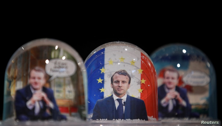 Snowglobes depicting French President Emmanuel Macron, made by Bruot company in eastern France, are displayed at a store in Paris, France, Nov. 17, 2017.